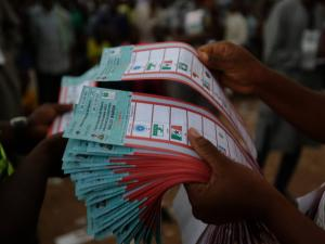 Election officials count ballots papers at the end of voting in one of the polling stations in Yola, Nigeria. Photo credit: Sunday Alamba